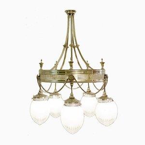 Lámpara de araña francesa antigua de bronce y cristal tallado