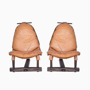 Sillones brasileños de madera tropical y cuero coñac, años 60. Juego de 2