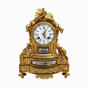 Reloj de péndulo francés Napoleón III antiguo de bronce dorado y porcelana