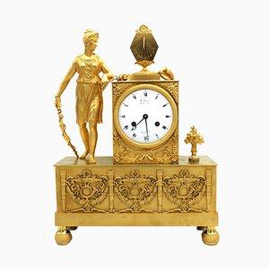 Reloj francés estilo imperio antiguo con péndulo de bronce dorado