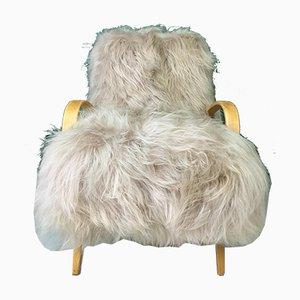 Vintage Sessel mit braunem Schafsfellbezug