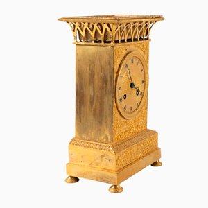 Reloj antiguo de bronce dorado, década de 1830