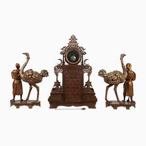 Juego de candelabro y reloj decorativo antiguo. Juego de 3