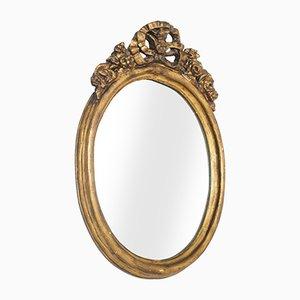 Espejo ovalado de madera dorada, siglo XVII