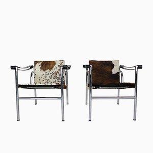 Modell LC1 Armlehnstühle mit Gestell aus verchromtem Metall & Bespannung aus Ponyleder von Le Corbusier für Cassina, 1970er, 2er Set