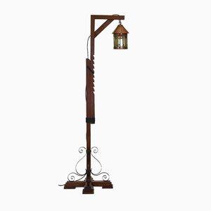 Lámpara de pie de roble, cobre y vitral, años 20
