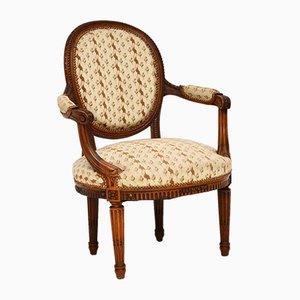 Antiker französischer Stuhl aus geschnitztem Nussholz