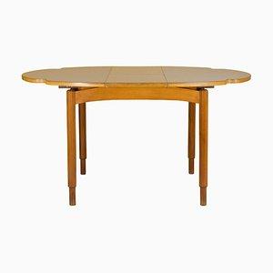 Mesa de comedor italiana extensible de madera con lámina de plástico en blanco, años 60