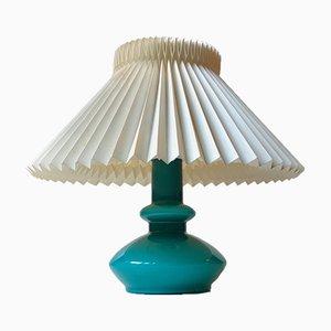 Lámpara de mesa danesa vintage de vidrio turquesa de Holmegaard, años 70