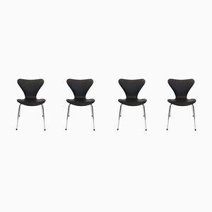 Modell 3107 Esszimmerstühle mit schwarzem Lederbezug von Arne Jacobsen für Fritz Hansen, 1980er, 4er Set