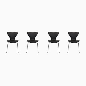 Sillas de comedor modelo 3107 de cuero negro de Arne Jacobsen para Fritz Hansen, años 80. Juego de 4
