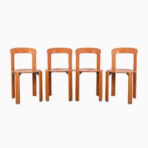 Stapelbare deutsche Modell 33 Esszimmerstühle in Orange von Bruno Rey für Dietiker, 1970er, 4er Set