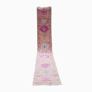 Alfombra de pasillo Oushak turca vintage en rosa pálido, años 70