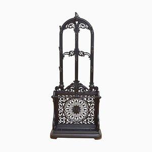Mueble de recibidor antiguo de hierro fundido