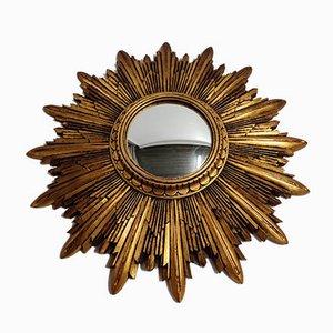 Espejo sol de resina dorada, años 60