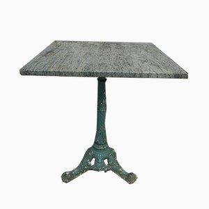 Mesa de jardín antigua de hierro fundido y mármol