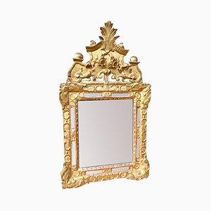 Espejo antiguo de mercurio y madera dorada