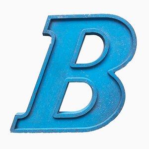 Blauer Vintage Metallbuchstabe