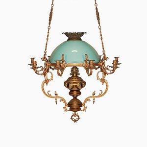 Lámpara de araña antigua de bronce y vidrio opalino