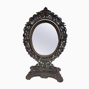 Spiegel mit polychromem Rahmen aus Gusseisen, 19. Jh.