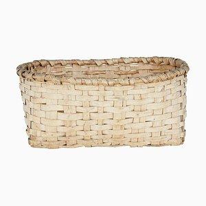 Cesta antigua de pino tejido
