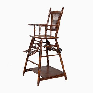 Antiker Kinderstuhl aus Holz & Gusseisen mit Sitzgeflecht