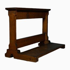 Banco de oración antiguo de roble