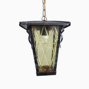Lámpara colgante de hierro y vidrio ámbar, años 50