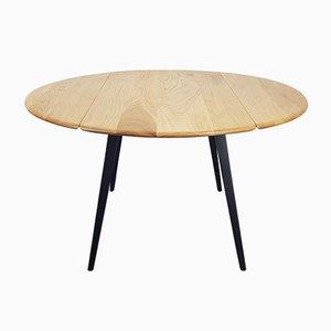 Mesa de comedor redonda en negro de Lucian Ercolani para Ercol, años 60
