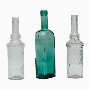 Juego de botellas de farmacia de vidrio, años 20. Juego de 3