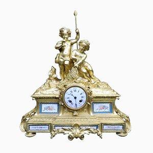 Orologio Napoleone III antico in bronzo dorato e porcellana, Francia, fine XIX secolo