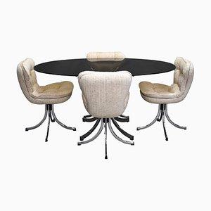 Juego de mesa y sillas de comedor italiano de metal cromado y vidrio ahumado, años 70. Juego de 5