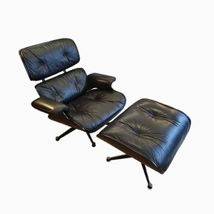 Vintage Black Leather and Ash Lounge Chair and Ottoman Set by Charles & Ray Eames for Mobilier International, 1970s
