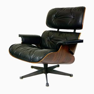 Butaca de palisandro y cuero negro de Charles & Ray Eames para ICF, años 60
