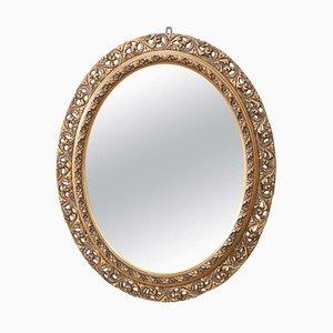 Espejo de pared modernista antiguo oval de madera dorada y tallada, años 10