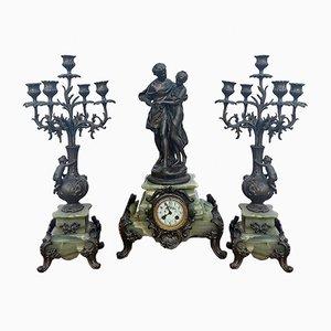 Juego de reloj de mesa y candelabros antiguos de Math Moreau