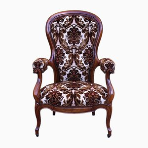 Antiker Sessel mit Gestell aus Nussholz