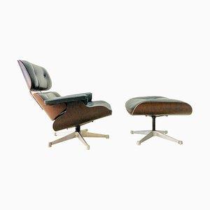 Poltrona e poggiapiedi in pelle di Charles & Ray Eames per Vitra, anni '80