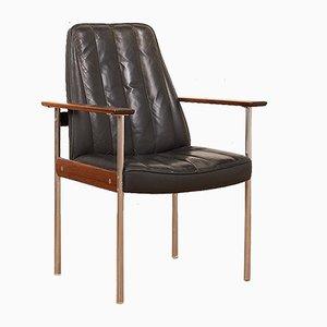 Butaca de acero tubular, palisandro y cuero negro de Sven Ivar Dysthe para Dokka Møbler, años 60