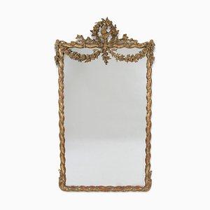 Espejo antiguo grande de madera dorada decorado con pájaro y guirnalda floral