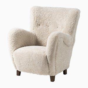 Dänischer Sessel mit Schaffellbezug von FDB, 1950er