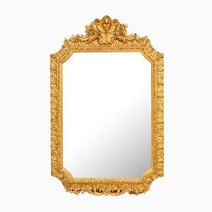 Espejo francés antiguo con marco de madera dorada