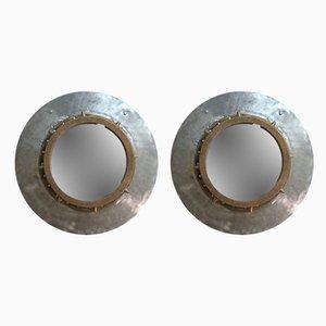 Espejos industriales de aluminio remachado y bronce, años 20. Juego de 2