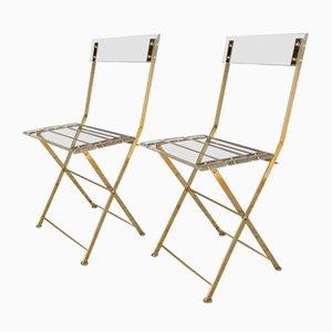 Französische Esszimmerstühle aus Plexiglas & vergoldetem Messing, 1970er, 2er Set