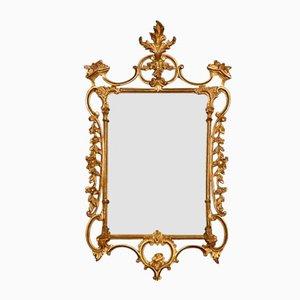 Espejo estilo rococó antiguo de madera dorada