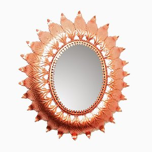 Espejo en forma de sol de metal y cobre, años 60
