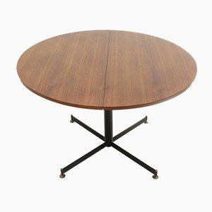 Mesa de comedor extensible italiana redonda de teca y metal, años 60