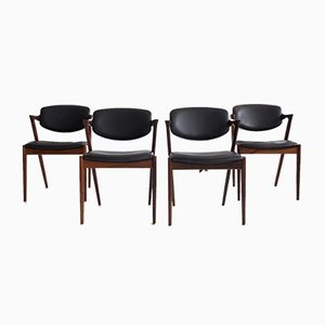 Model 42 Rosewood and Black Leather Dining Chairs by Kai Kristiansen for Schou Andersen, 1950s, Set of 4