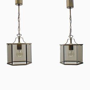 Lámparas de techo alemanas de vidrio ahumado y latón, años 60. Juego de 2