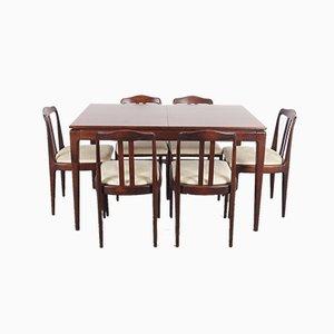 Mesa de comedor y sillas, años 70. Juego de 7
